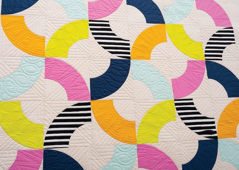 Bold quilt with stripes and color