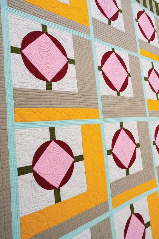 Mustard, pink and burgundy quilt