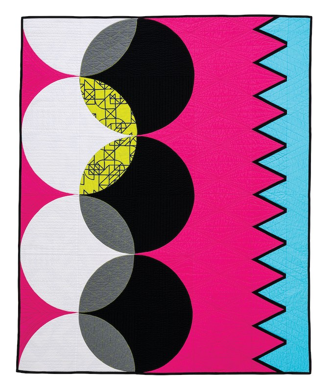 Pink and turquoise quilt