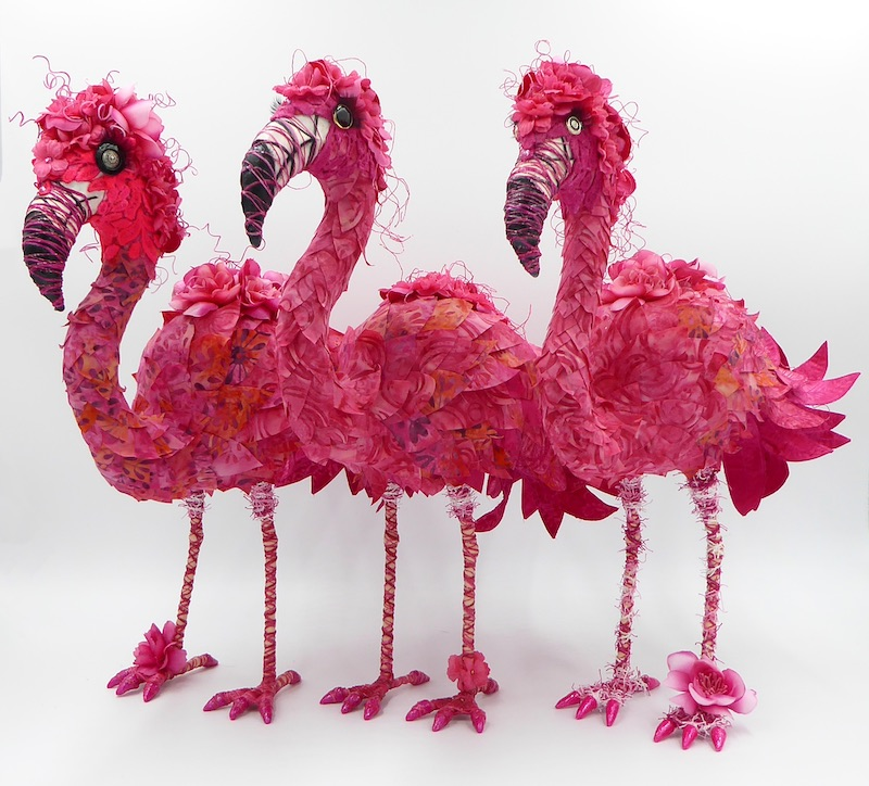 From left: Cora, Flossie and Peaches, a trio of flamboyant flamingos