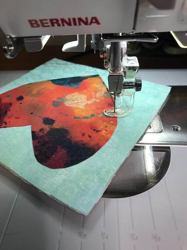 Beginning stitching around the heart