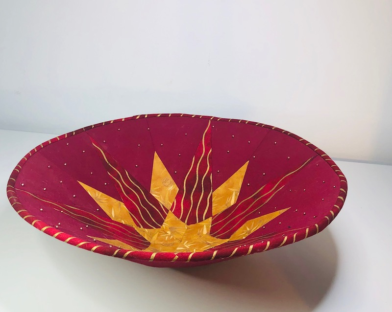 Red and gold fabric bowl side view