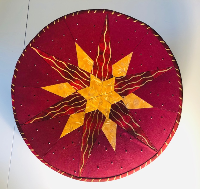 Red and gold fabric bowl