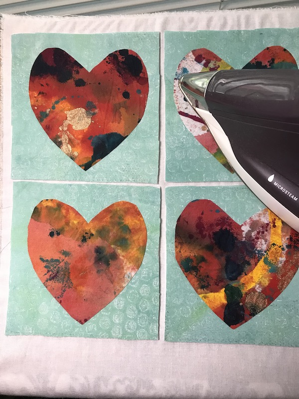 Pressing the hearts on the background with backing