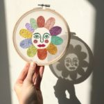 Embroidered flower face