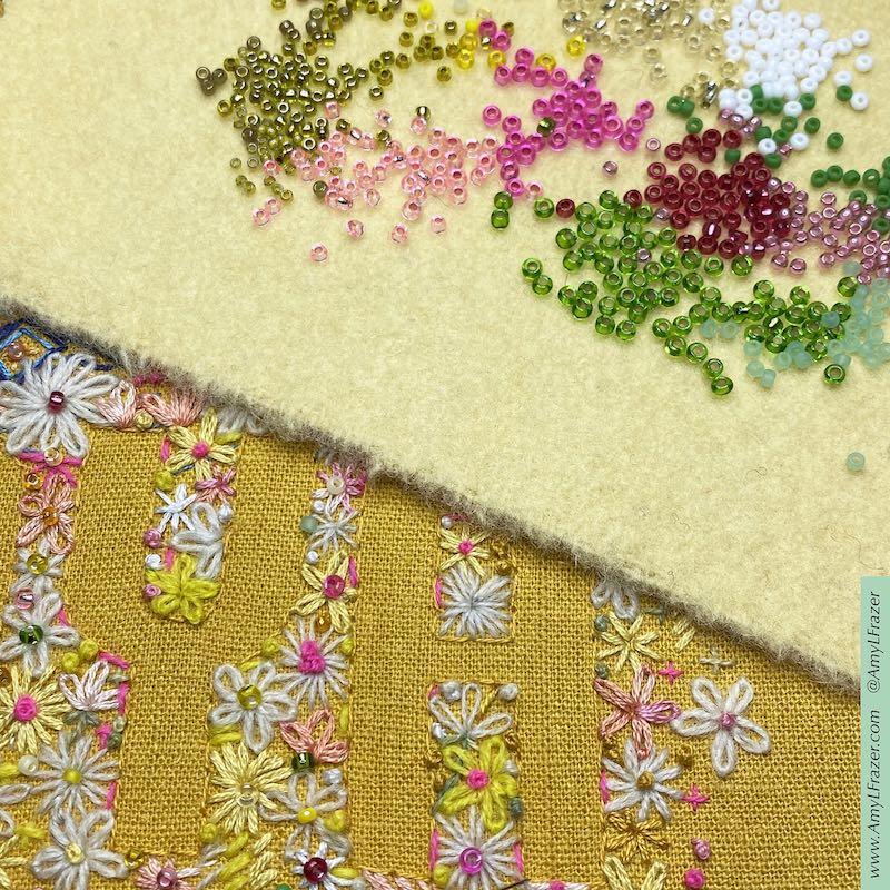 Close up of adding beads to Maya embroidery