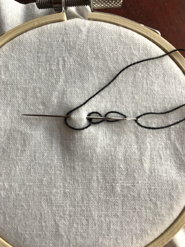 Starting the third stitch for chain stitch embroidery