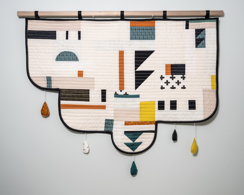 Modern quilt in teal and orange by Emily Bellinger