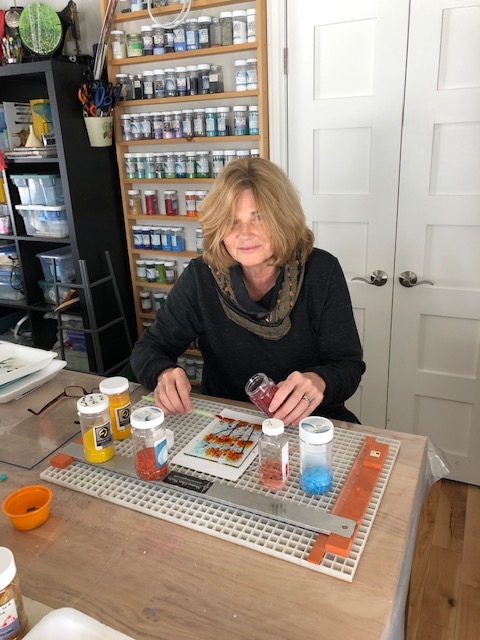 Joyce working on a fused glass piece