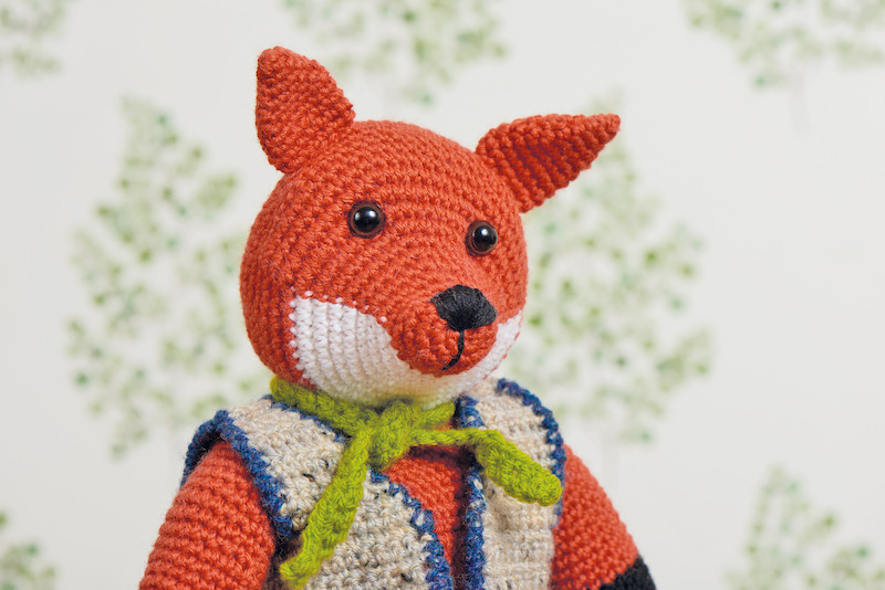 Crochet fox with a vest and tie