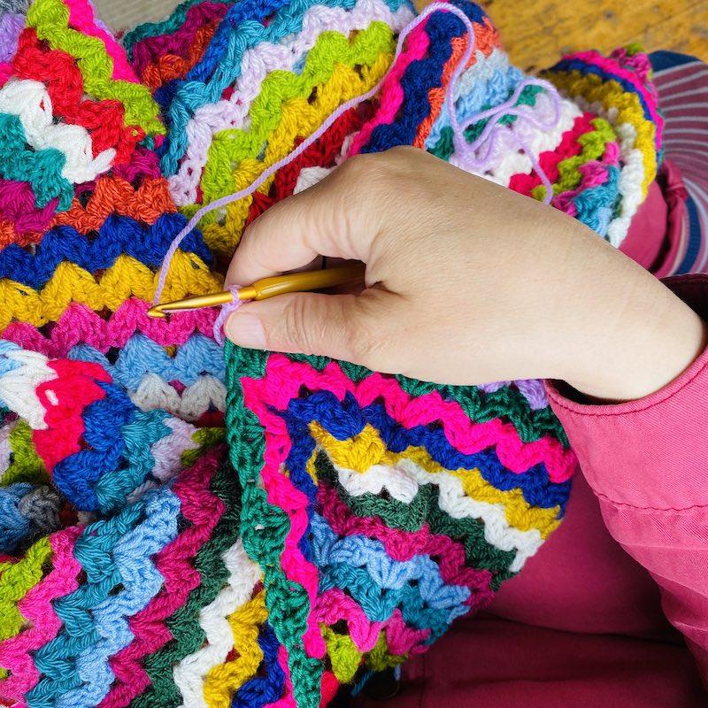 Emma crocheting