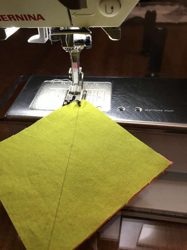 Starting to sew two half square triangles at once