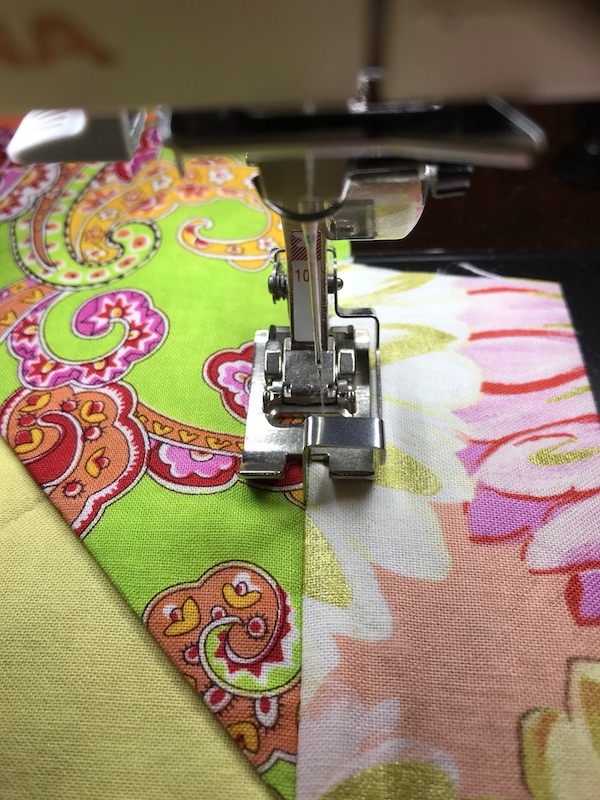 Stay stitching the facing of the quilt