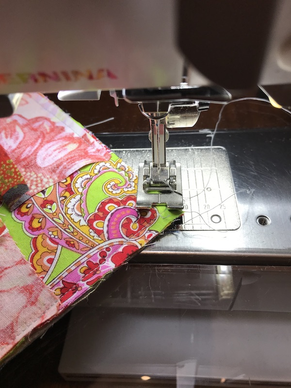 Stitching across the corner of the quilt