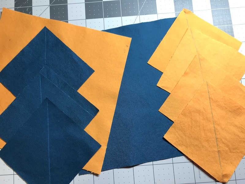 No Waste Flying Geese fabric cut out and marked