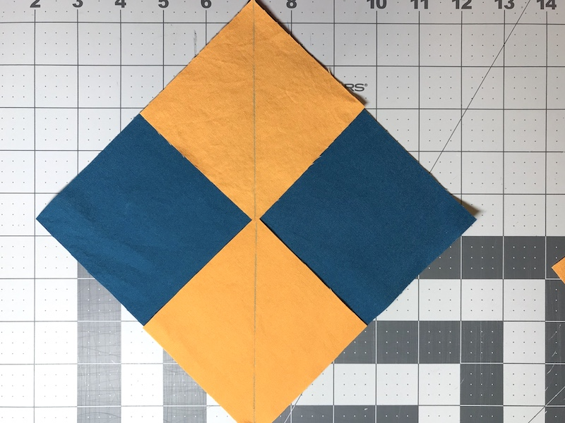 No Waste Flying Geese laying smaller squares on larger square