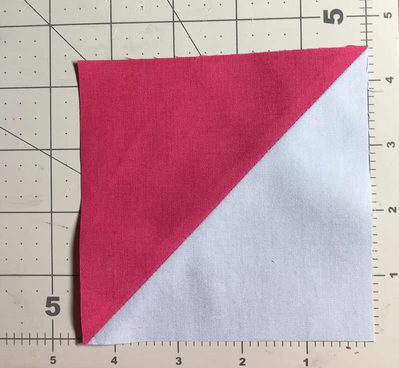 Half square triangles 8 at a time from a layer cake trimmed to 4-1/2 inches
