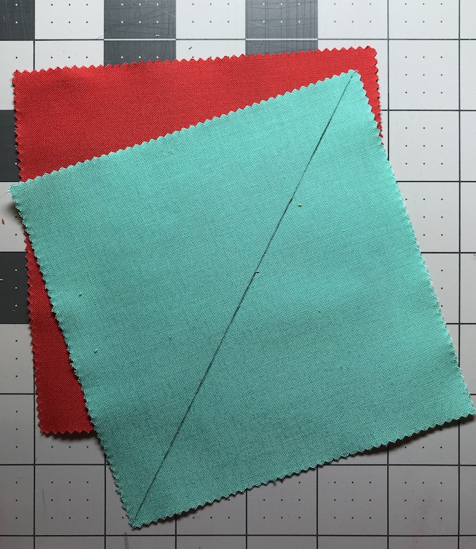 Half square triangles two at a time from a charm pack marked