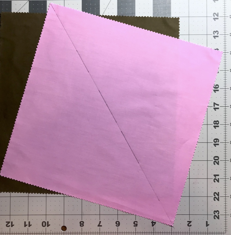 Half square triangles two at a time from a layer cake marked and ready to sew