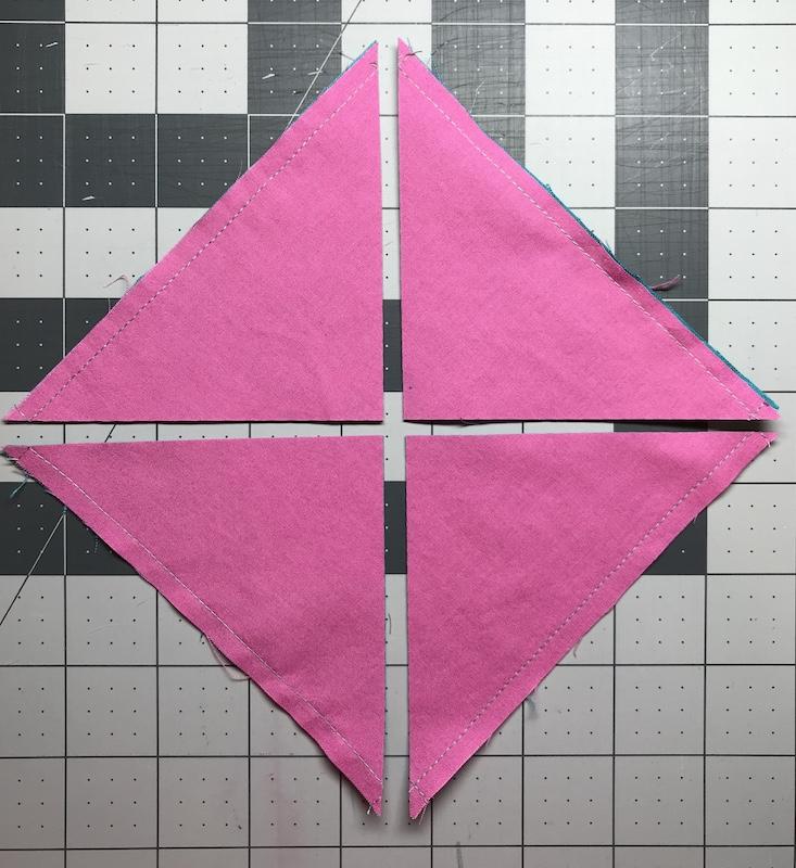 All four half square triangles are cut