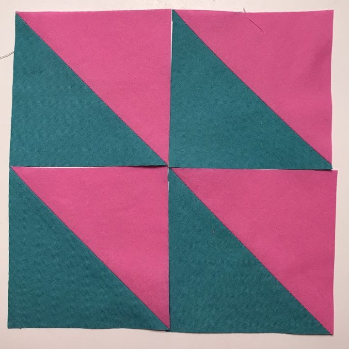 Half square triangles all trimmed and ready to sew together