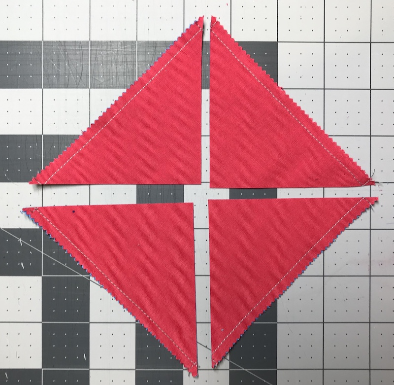 Half square triangles four at a time from a charm pack all cut out