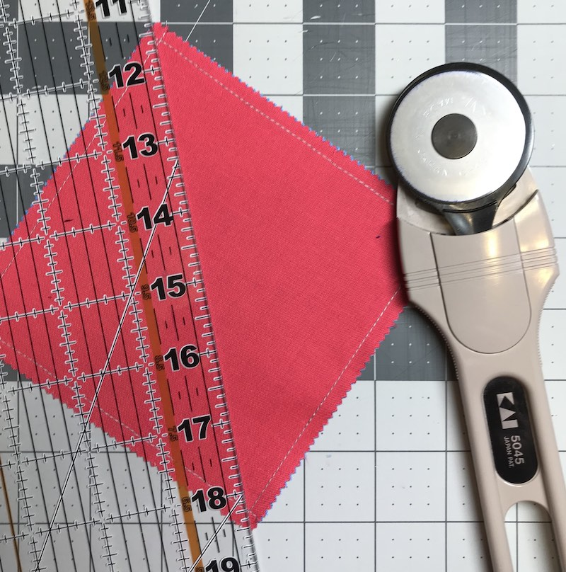 Half square triangles four at a time from a charm pack ready for first cut