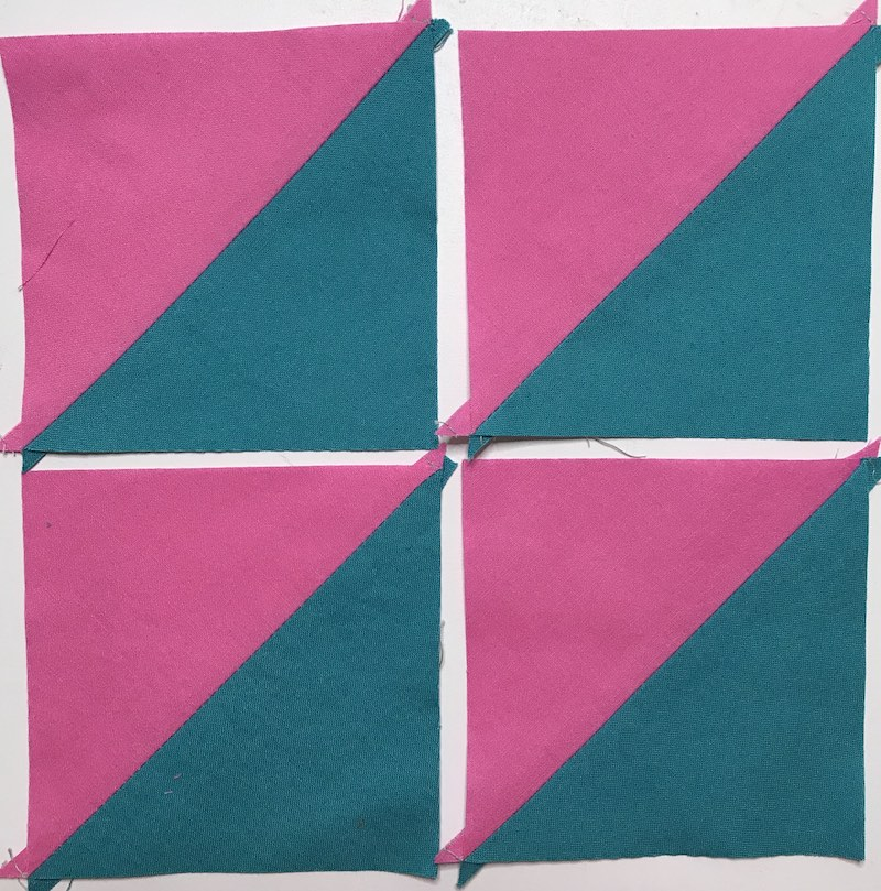 Finished four half square triangles at once