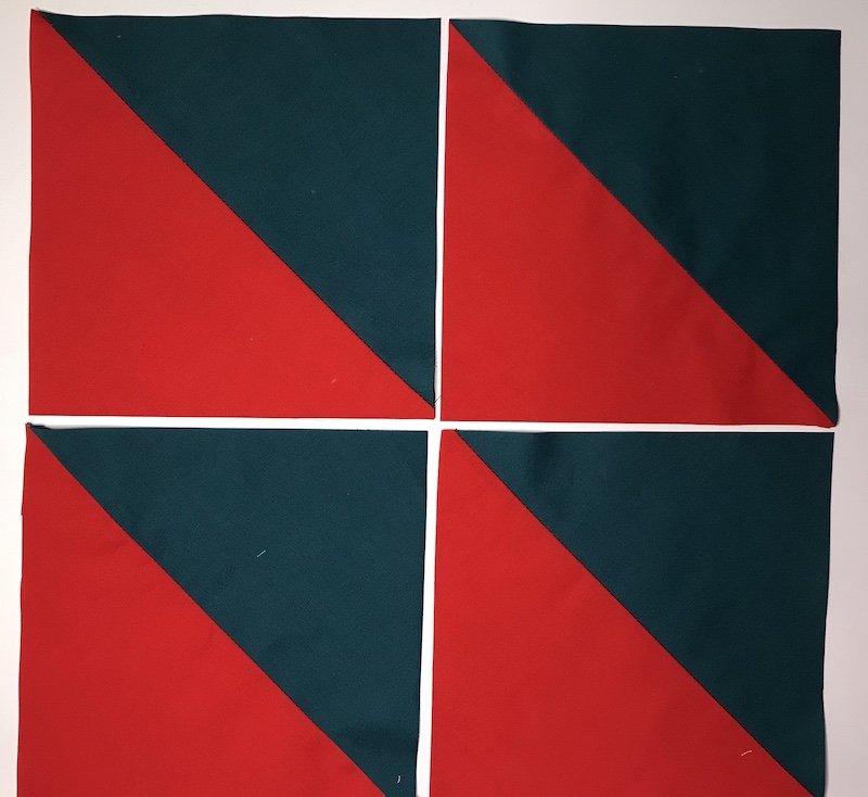 Half square triangles from a layer cake finished and trimmed