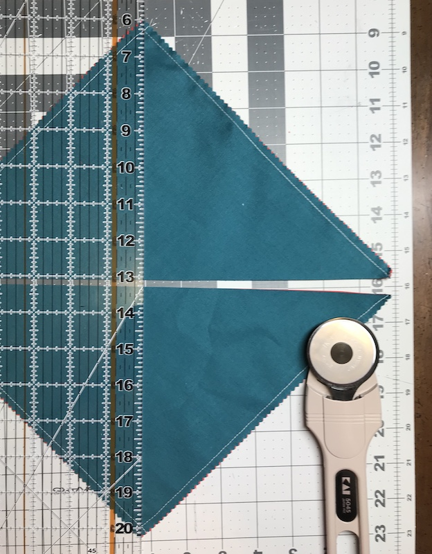 Half square triangles four at a time from a layer cake making the second cut