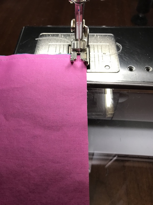 Sewing the second seam for half square triangles four at a time