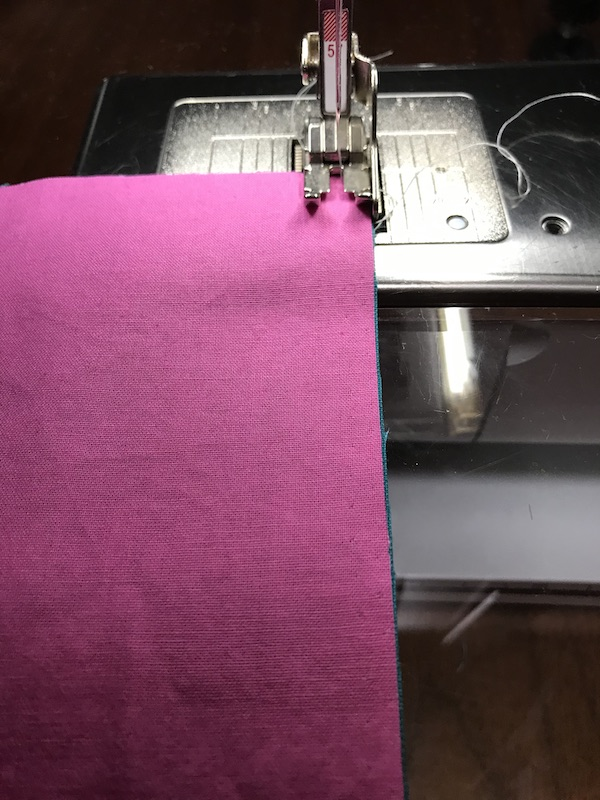 Sewing the first seam for half square triangles four at a time