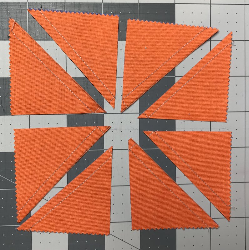 Half square triangles eight at a time from a charm pack all cut