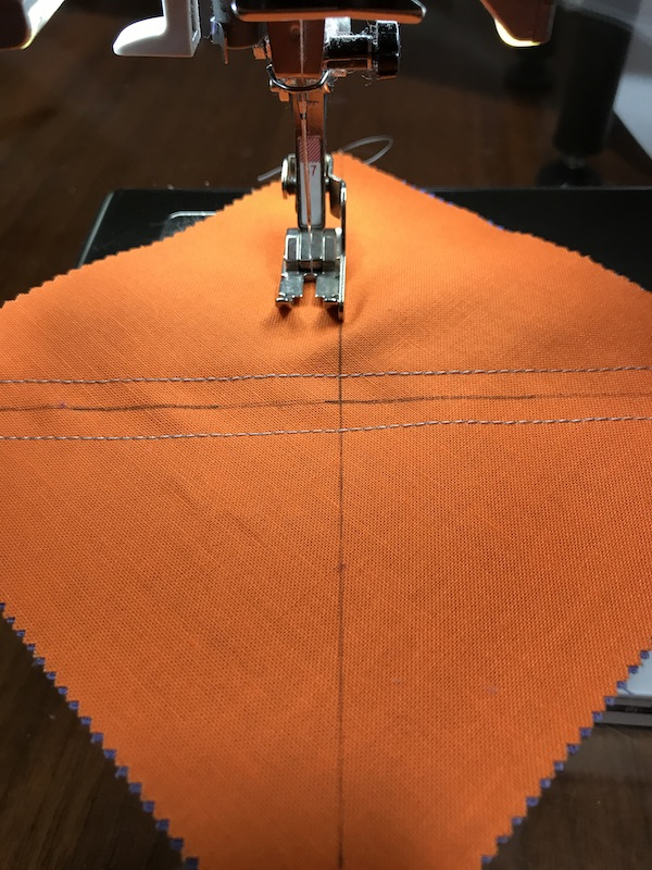 Sewing the third seam for half square triangles eight at a time with a charm pack