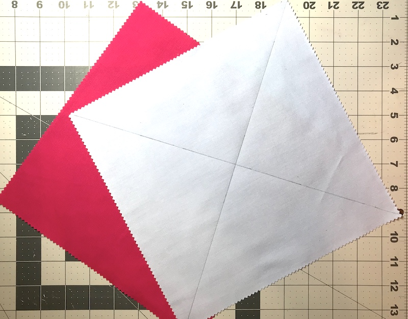 Half square triangles eight at a time from a layer cake marked and ready to sew