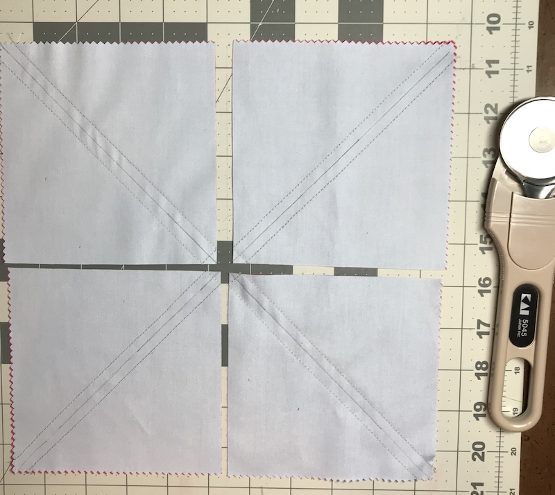 Half square triangles eight at a time from a layer cake ready for the final cuts