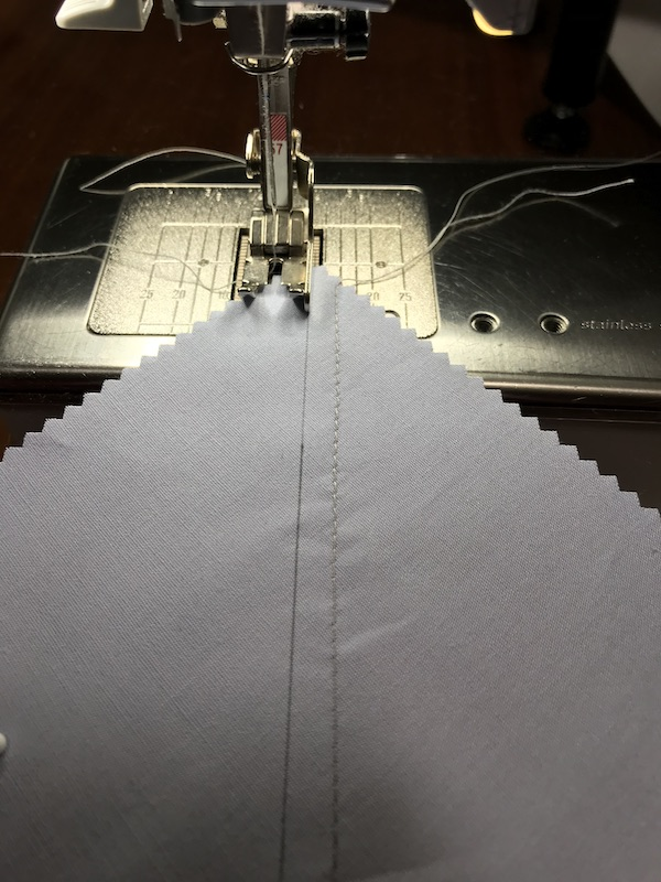 Sewing the second seam to make eight half square triangles at a time from a layer cake