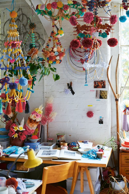 A corner filled with colorful mobiles