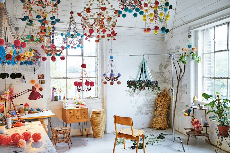 A room full of Karolina's mobiles and chandeliers