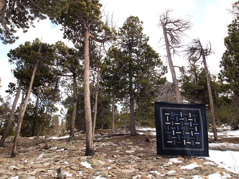 Blue quilt hung in nature