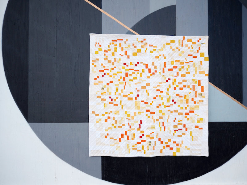 Orange yellow and white quilt