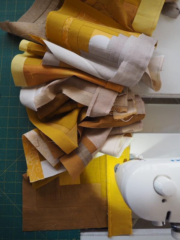 Work in progress on gold quilt