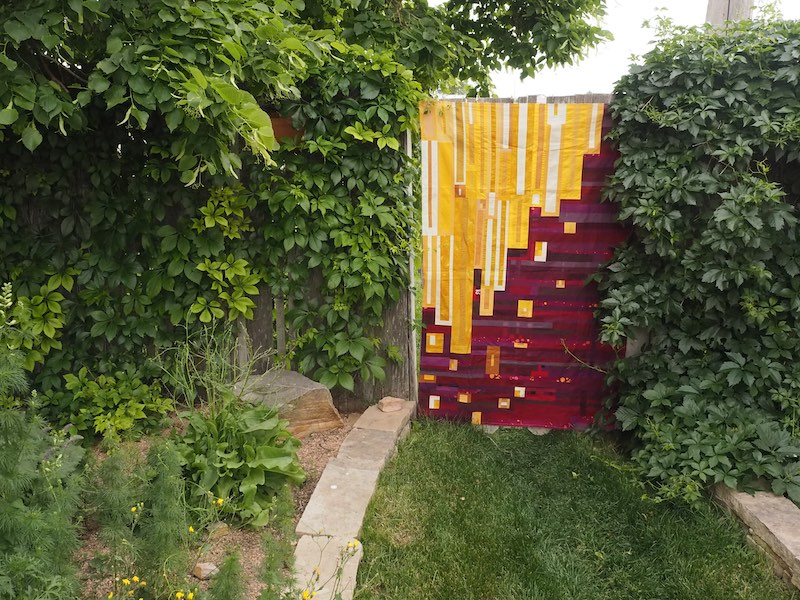 Gold and burgandy quilt in nature