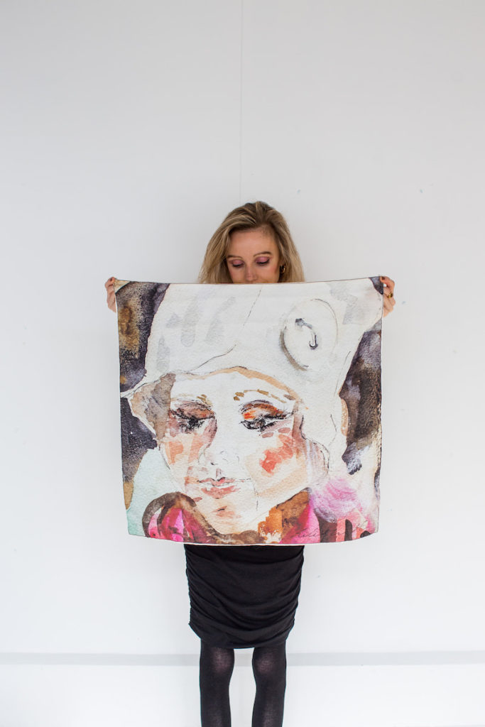 Allish holding up one of her pieces