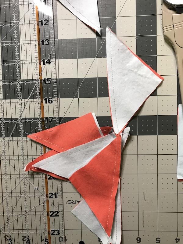 Half square triangles sewn together in a strip