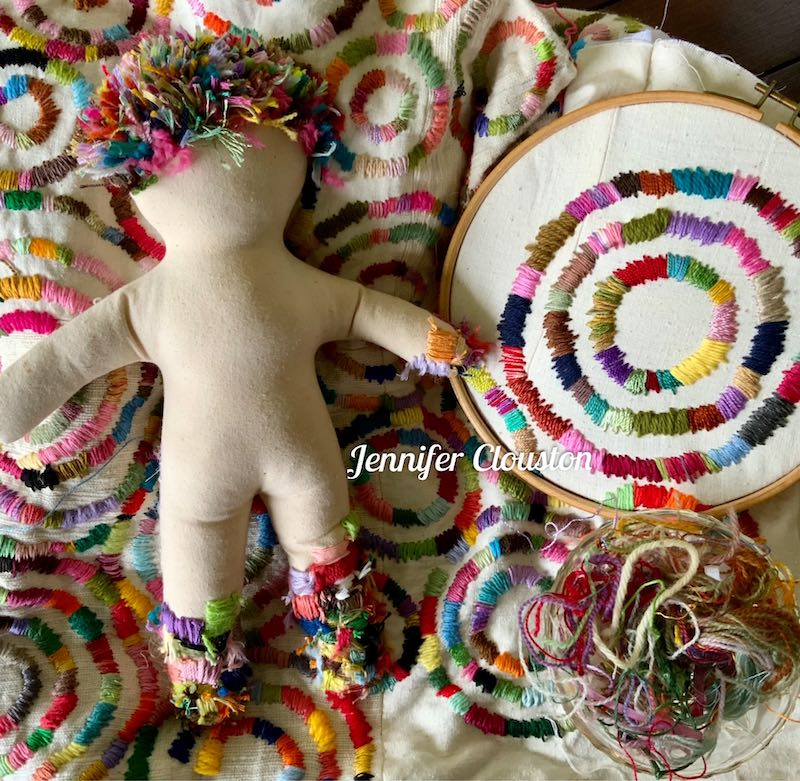 Stitched doll and ort embroidery