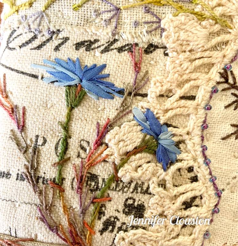 Close up of embroidery on sewing clutch