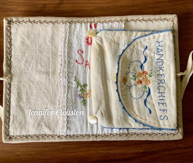 Sewing clutch made from repurposed vintage linens