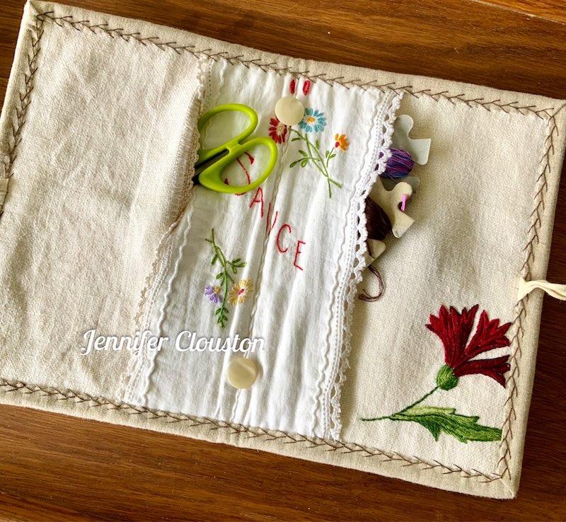 Inside of repurposed vintage linen sewing clutch