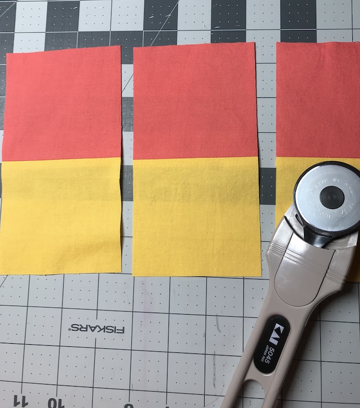 Cutting strips into pieces for nine patch quilt block